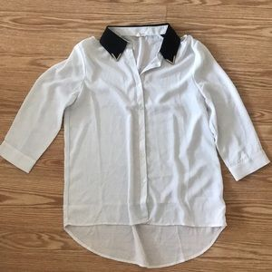 White blouse with black silver-tipped collar